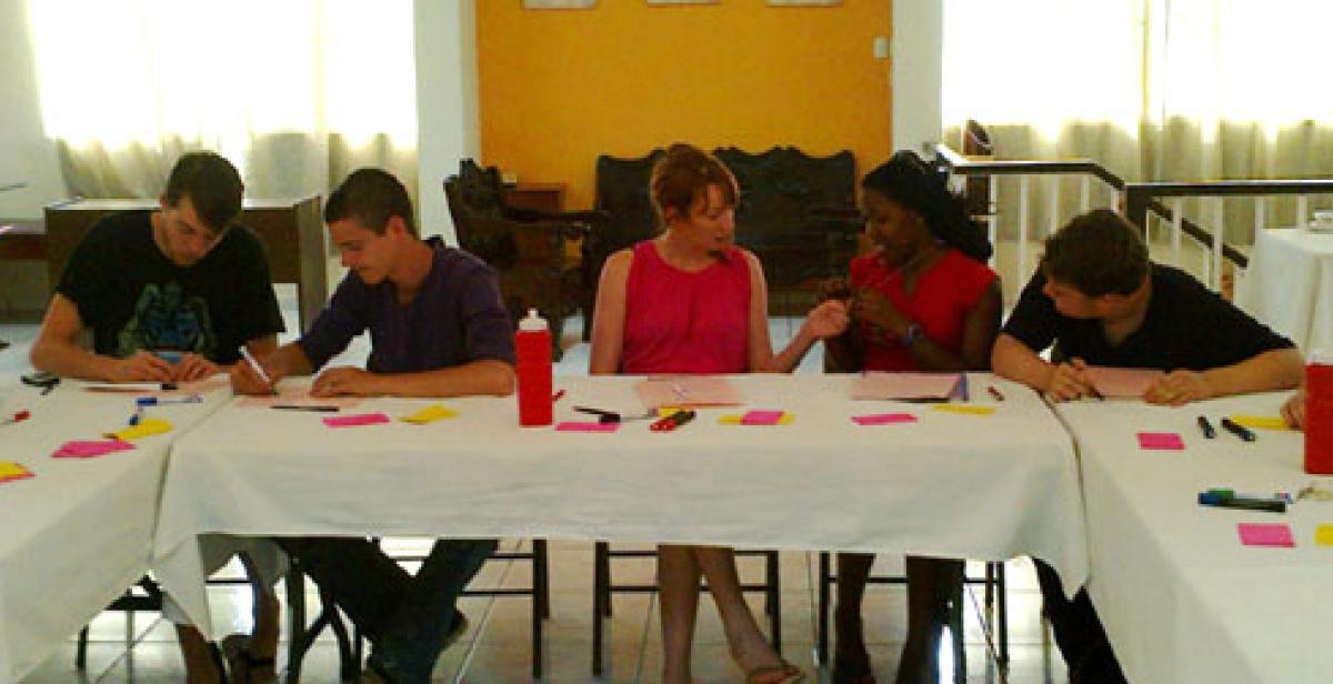 ICS Empower volunteers sitting at a table