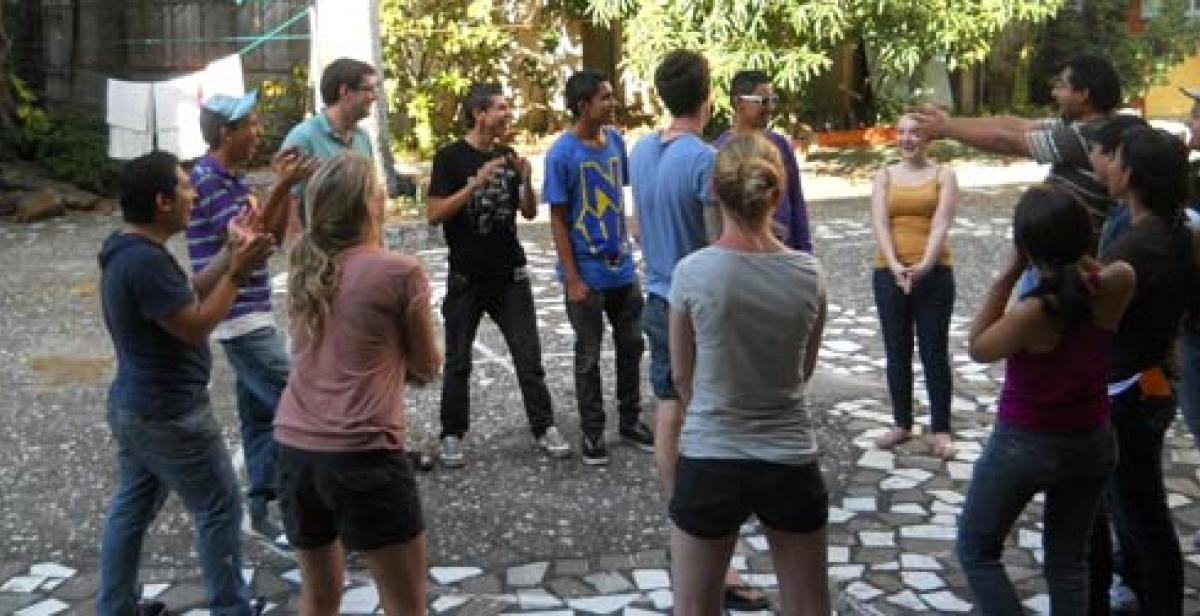 ICS Progressio volunteers talking in courtyard
