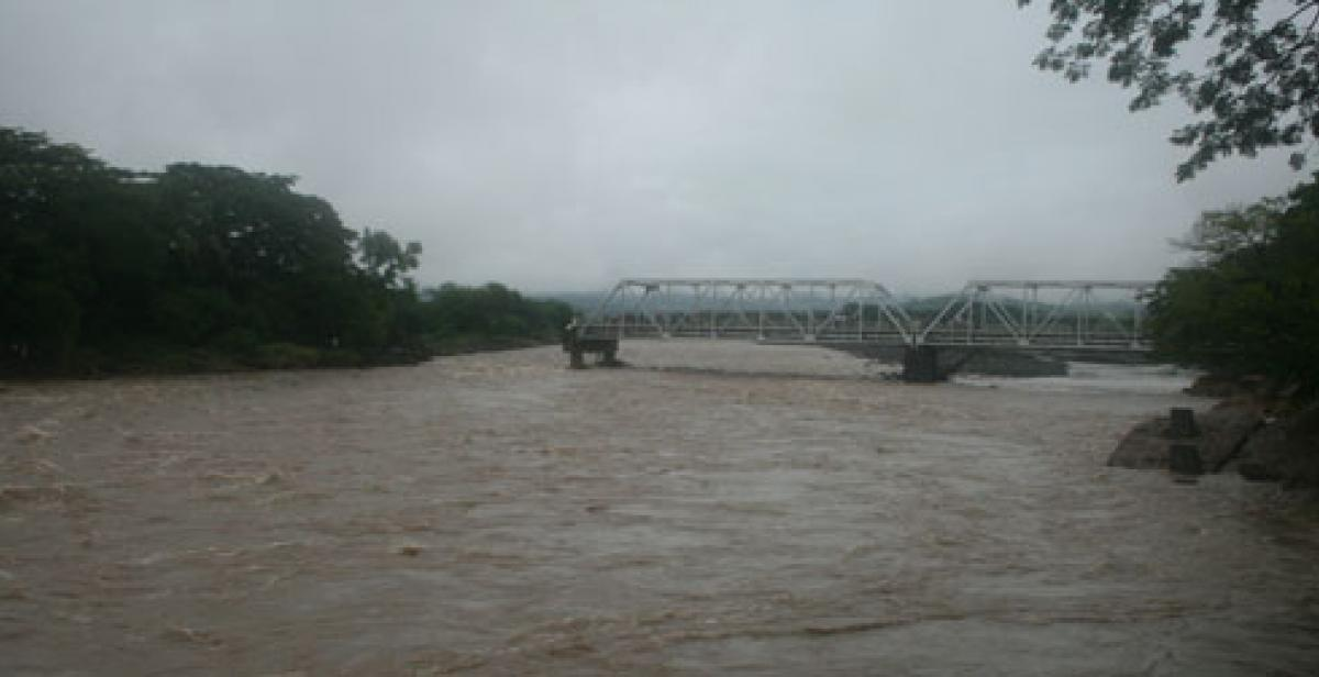 Bridge damaged by floods on El Salvador border