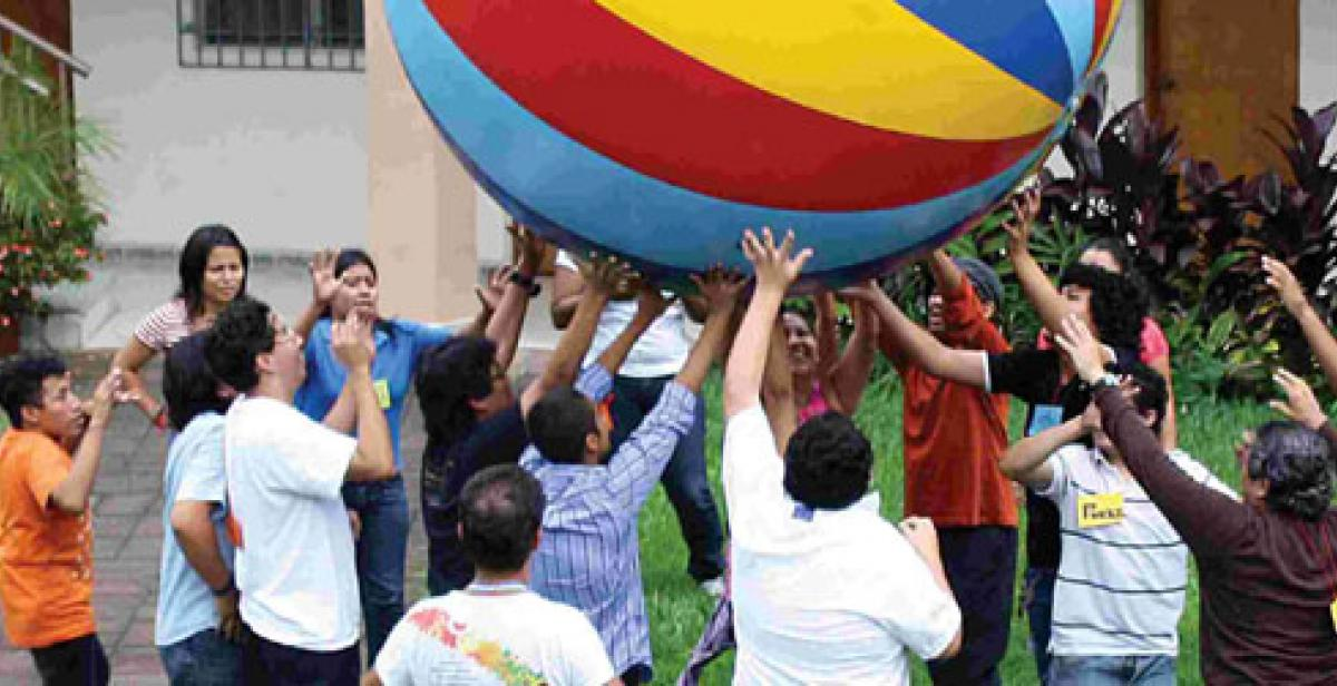 People holding up a coloured ball