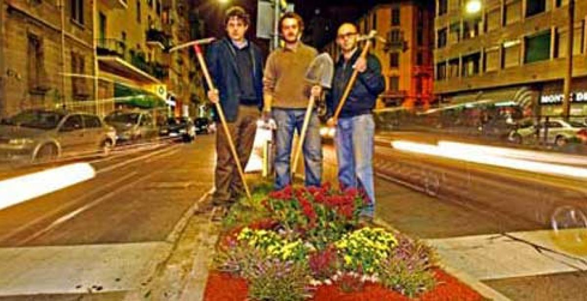 Guerilla gardeners pose by their new gardens in the dead of night