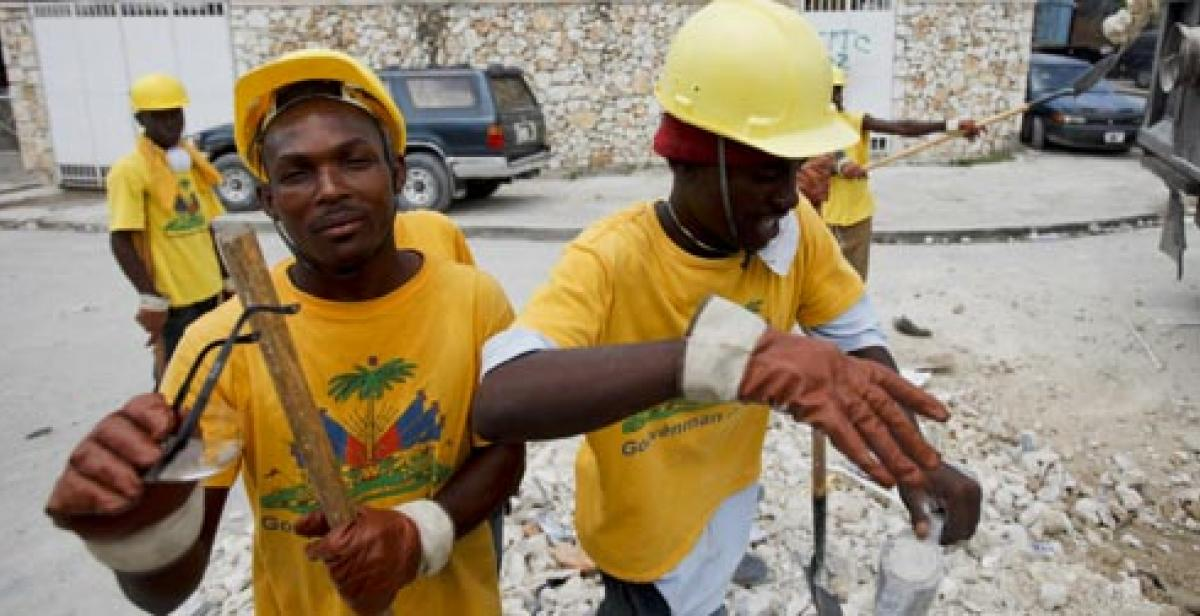Haitian workers clear rubble in streets of Port-au-Prince