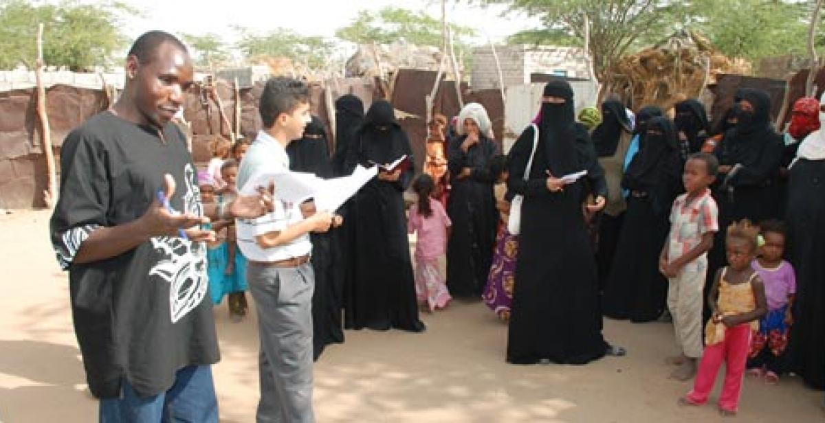Joseph Aloo discussing community needs with women in Hodeidah Yemen
