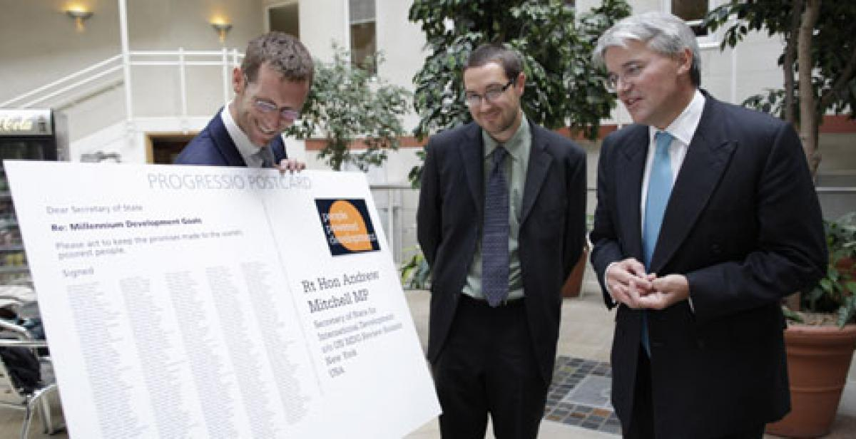 Giant postcard of MDG petition is presented to Andrew Mitchell MP