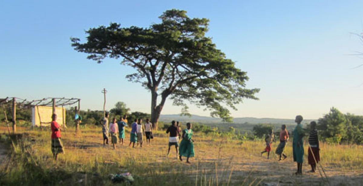 Girls playing in field in Mzimba, Malawi