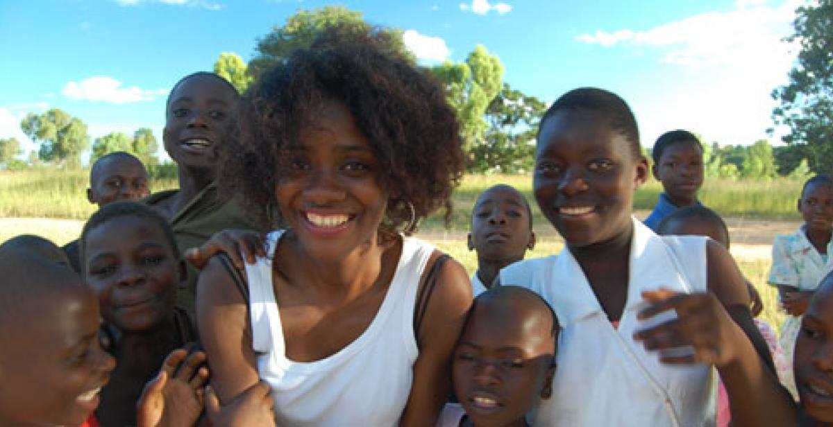 Volunteer Tashann with children in Malawi