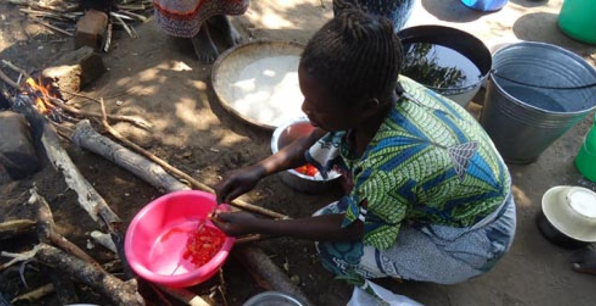 A woman preparing food in Malawi