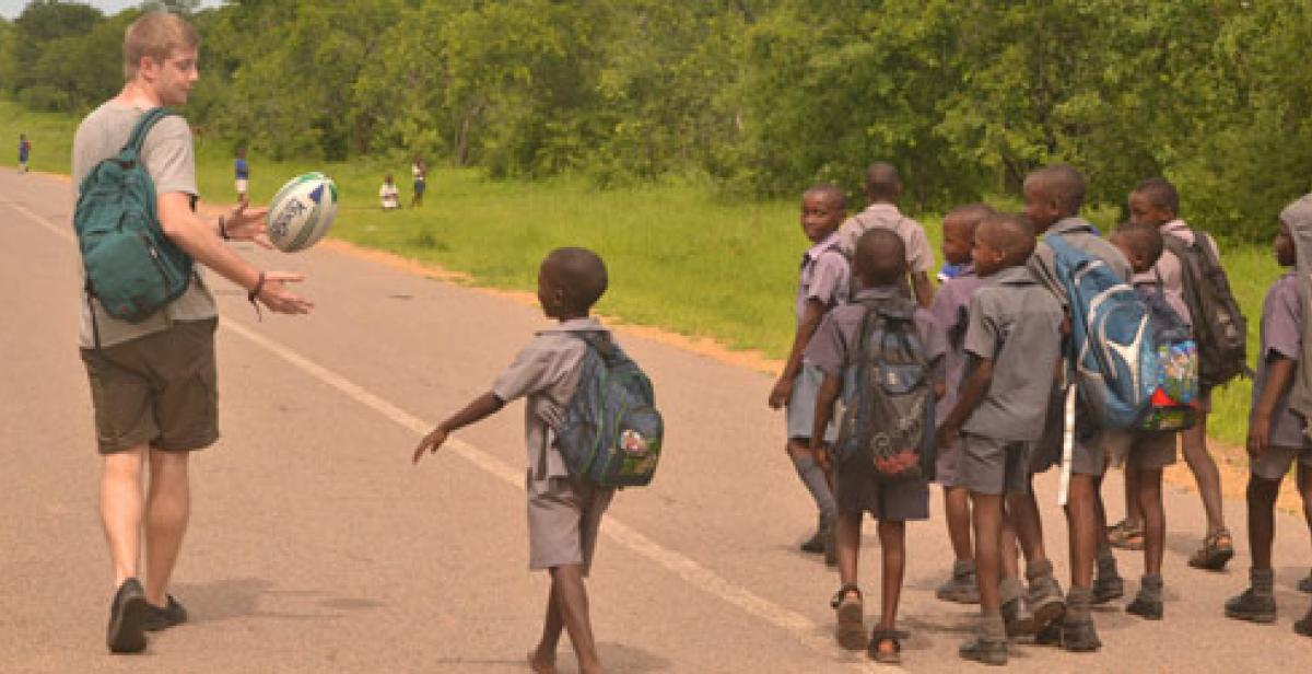 Progressio ICS UK volunteer with school children in Zimbabwe