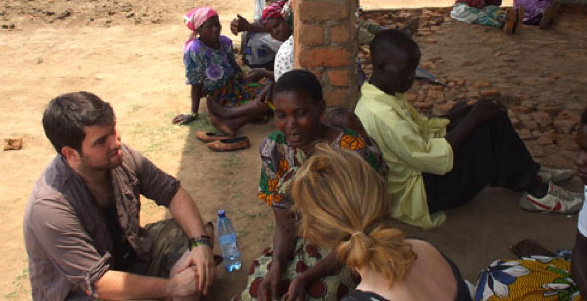 ICS volunteers talking to villagers in Malawi