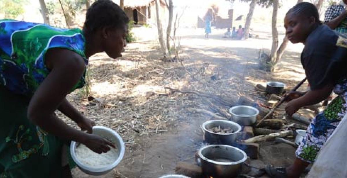 Women cooking in a village in Malawi