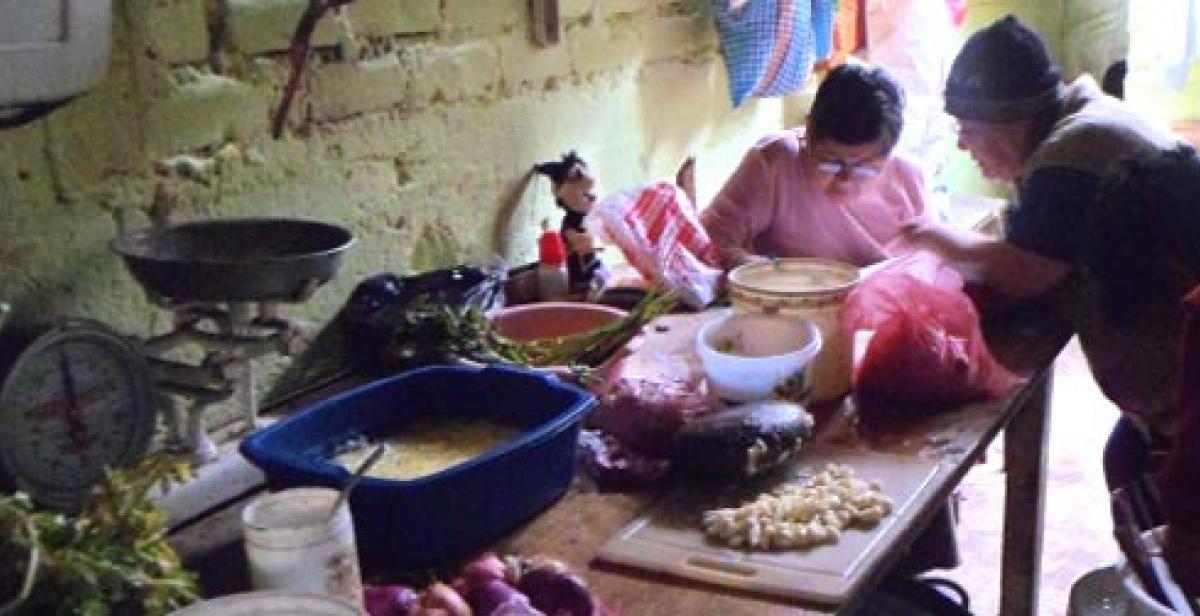 Women preparing a meal at the 'comedor' in Villa El Salvador, Peru