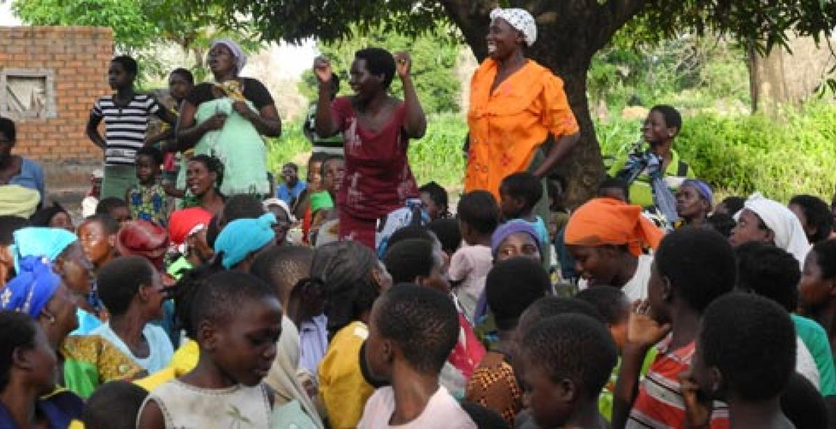 Women and children celebrate tree planting