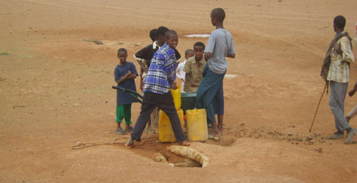 Somaliland: Boys collecting water at water hole