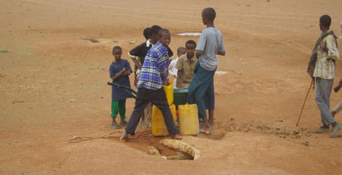 Somaliland: Boys collecting water at water hole