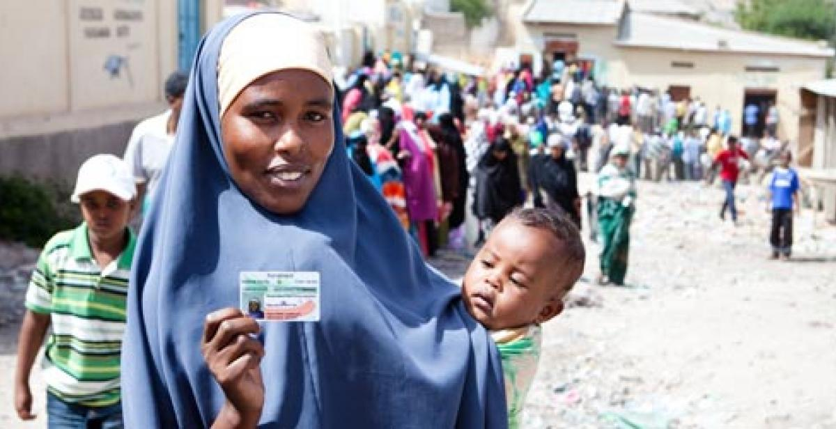 A woman in Somaliland holding her voting card on election day