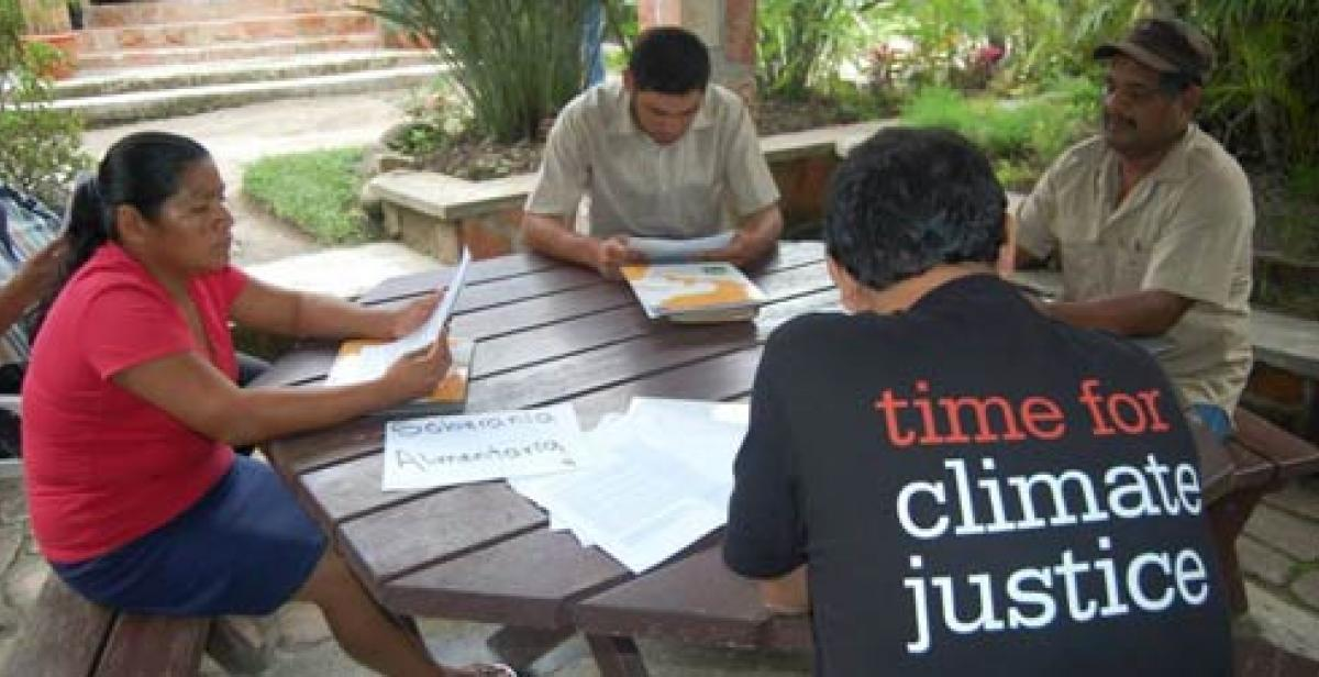 Time for Climate Justice campaigners sit around the table