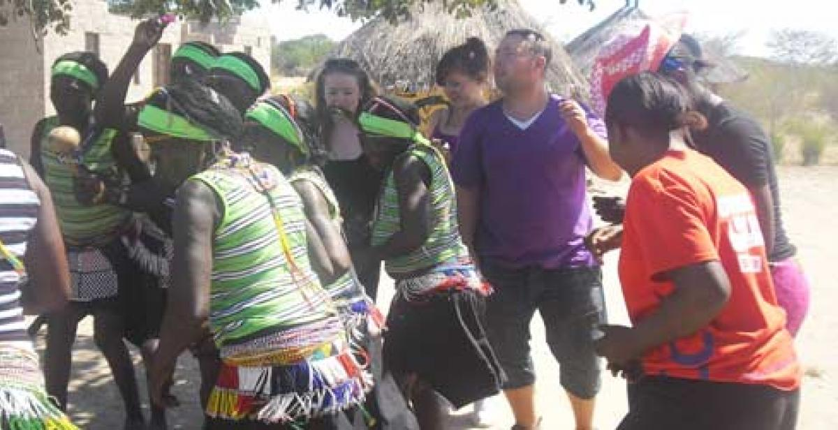 Volunteers dancing with the Lubu cultural dance group