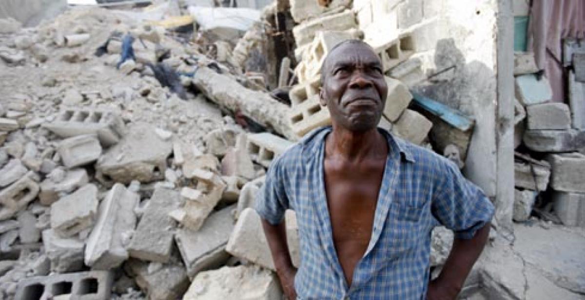 wilbert joseph surveys the rubble of his former home