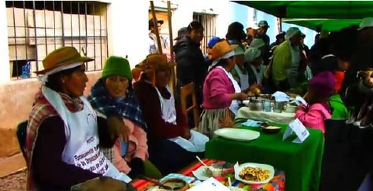 Women at a food fair in Huancavelica, Peru