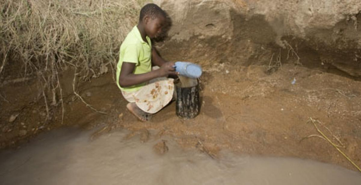 Girl collecting water in Zimbabwe