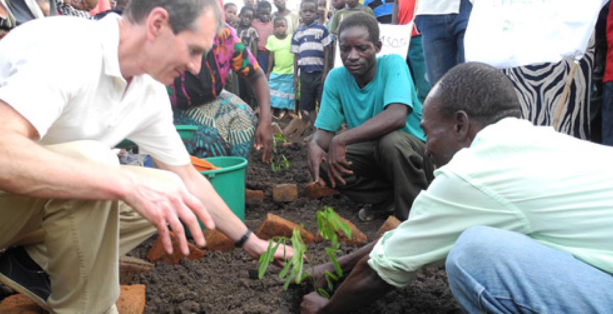 Mark plants a tree at Chembe village Forest Club, Malawi