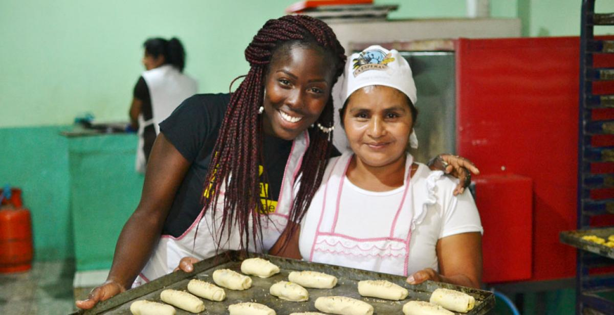 Volunteer supporting women's bakery in El Salvador