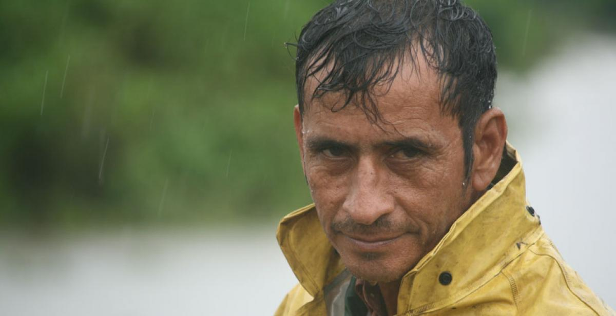 A man endures rainfall during a tropical storm