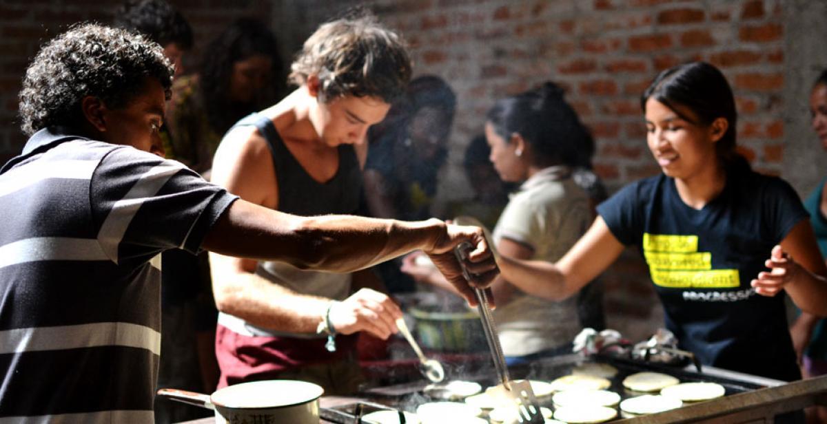 Volunteers supporting community cooking workshop