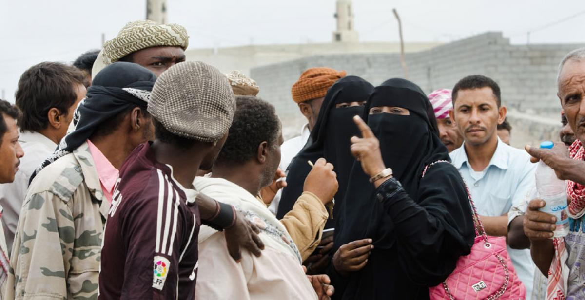 "Kvaiah Ebrahim, a ""women's champion"", talking to a group of men, Yemen"