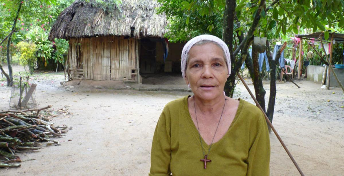 Mélida Tróchez outside her home in Honduras