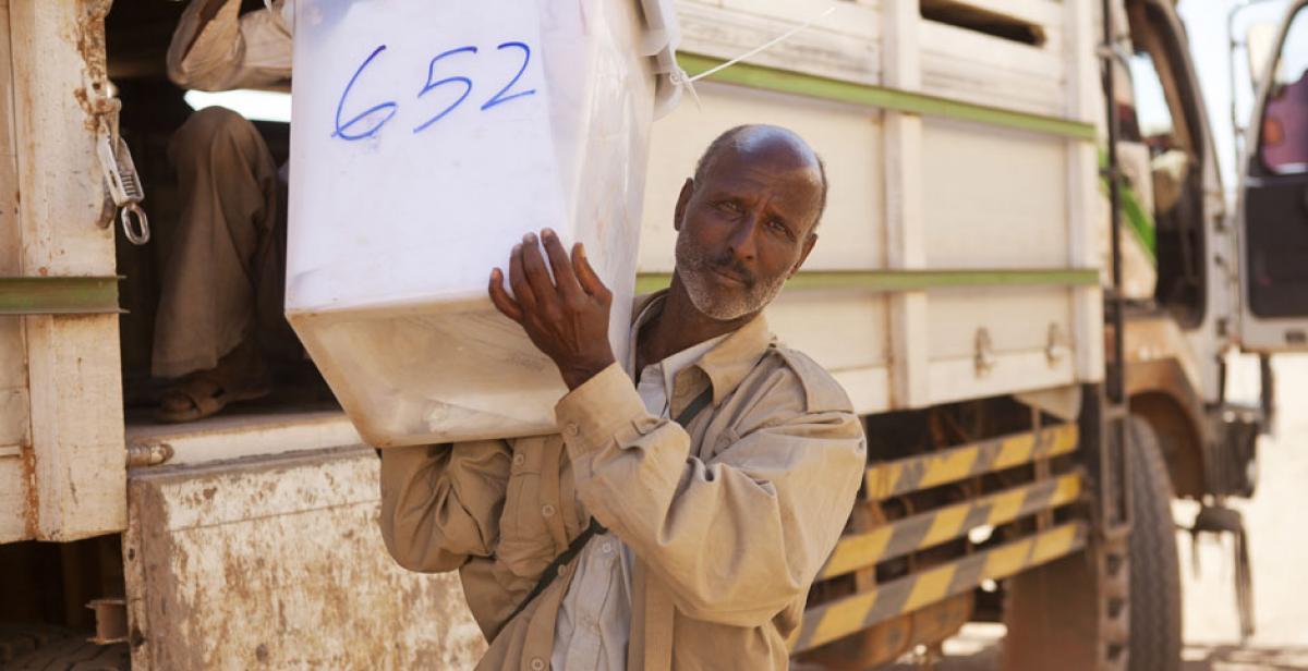 A man carrying a ballot box in Somaliland