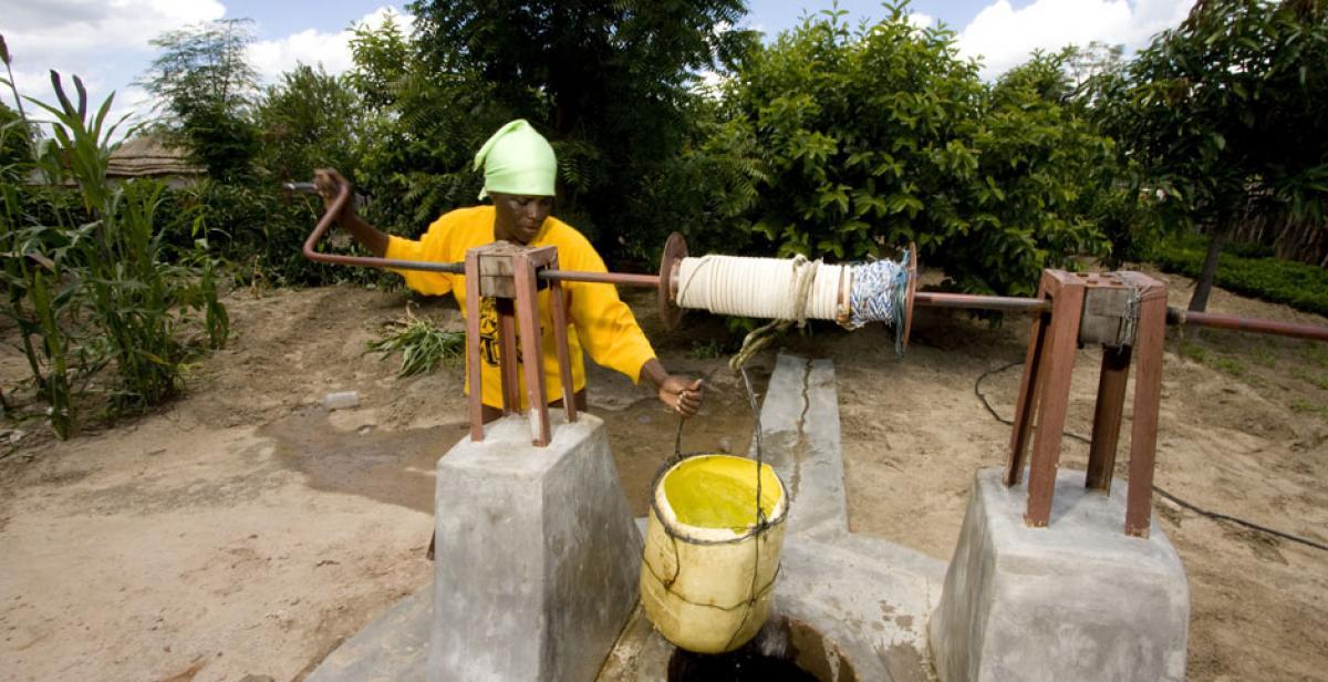 Litah Sibanda, a farmer in Lupane, Zimbabwe, drawing water from a well