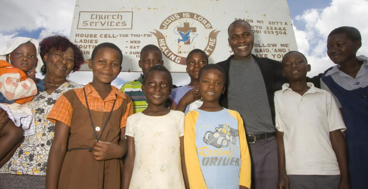 Clara Pindurai and Philemon Handinahama with school children