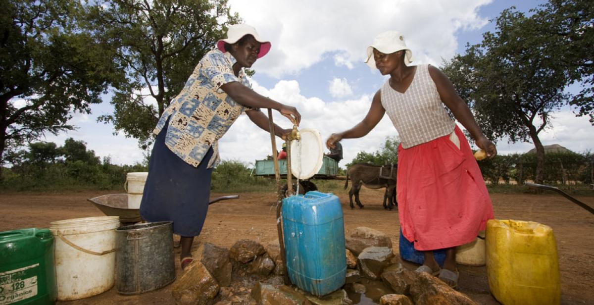 Senelisiwe Tshuma and Twist Moyo collecting water