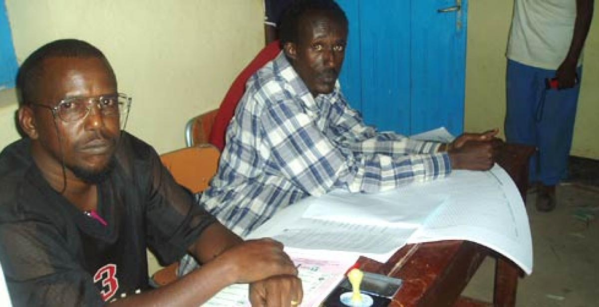 A polling station chairman awaits voters at the 2005 elections