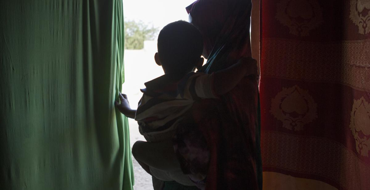 Mother and child in a village Progressio supported, Somaliland.