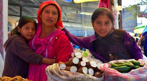 A Lenca woman and her two daughters selling their produce at a market in La Esperanza