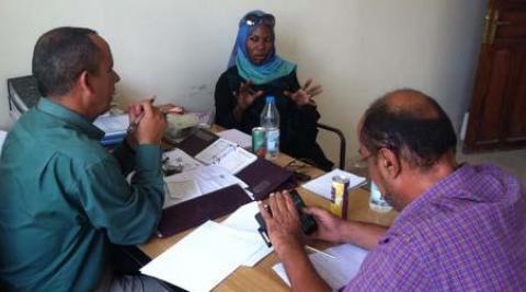Sarah Kamya at a meeting with colleagues