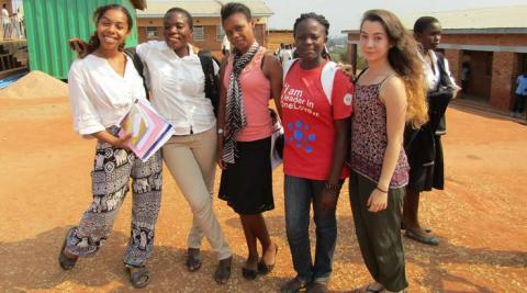 Volunteers Leah, Patricia, Tammie and Mphatso and Laura outside Masasa Secondary School following a successful peer education session