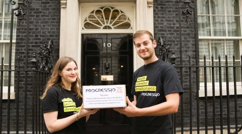 Jenny Vaughan, Campaigns Officer and Seb Scott, Action at Home Officer hand in petition to Number 10