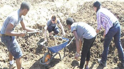 Digging a community fish pond