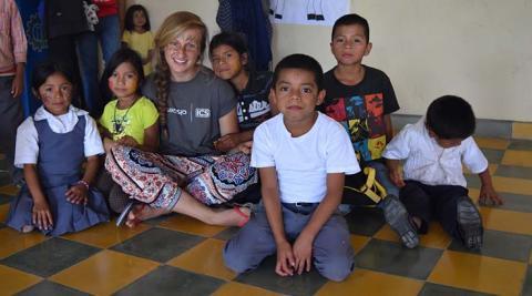 ICS volunteer with local school children at the event