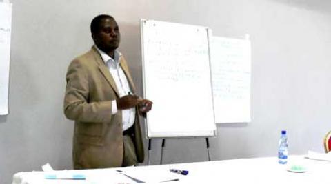 Mandlenkosi Mpofu making a presentation