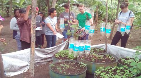 ICS Volunteers visiting a vegetable garden constructed by the previous cycle of volunteers