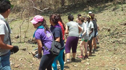 Volunteers collecting rocks for their eco-construction
