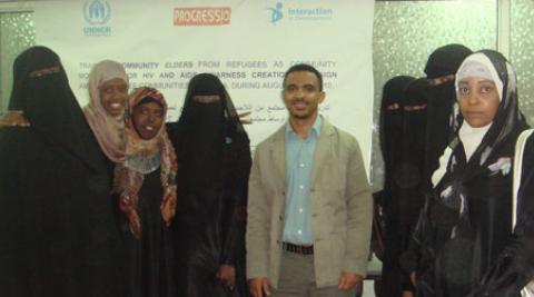 Development Worker Wondimu Regaa Guyassa with participants of a Refugee Community Mobilisers training