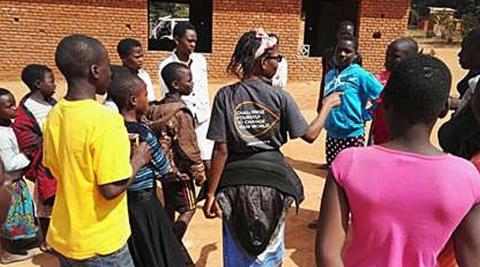 Volunteers from my team facilitating sexual health workshops in Malawi. (Photo by Kamilah McCarthy)
