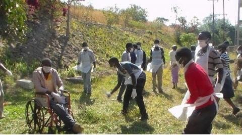 Volunteers help to clean up their local hospital in Malawi