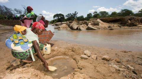 Pictured: Women collecting water in Zimbabwe, where a woman's role is often to become a wife and look after household chores.