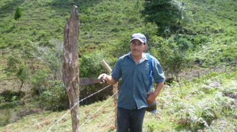 Agustin standing beside fence